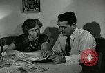 Image of family of auto worker Detroit Michigan USA, 1950, second 18 stock footage video 65675032774