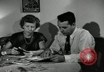 Image of family of auto worker Detroit Michigan USA, 1950, second 22 stock footage video 65675032774