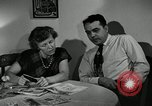 Image of family of auto worker Detroit Michigan USA, 1950, second 28 stock footage video 65675032774