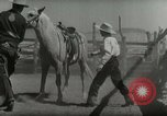 Image of Roundup of wild horses United States USA, 1943, second 36 stock footage video 65675032777