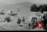 Image of Wagon trains of pioneers moving west United States USA, 1954, second 8 stock footage video 65675032789