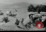 Image of Wagon trains of pioneers moving west United States USA, 1954, second 9 stock footage video 65675032789