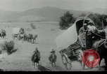 Image of Wagon trains of pioneers moving west United States USA, 1954, second 10 stock footage video 65675032789