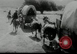 Image of Wagon trains of pioneers moving west United States USA, 1954, second 56 stock footage video 65675032789