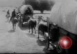 Image of Wagon trains of pioneers moving west United States USA, 1954, second 57 stock footage video 65675032789