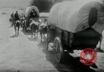 Image of Wagon trains of pioneers moving west United States USA, 1954, second 59 stock footage video 65675032789