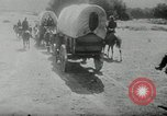 Image of Wagon trains of pioneers moving west United States USA, 1954, second 62 stock footage video 65675032789