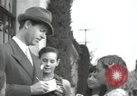 Image of Hollywood Actor give autographs Los Angeles California USA, 1936, second 1 stock footage video 65675032817