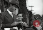 Image of Hollywood Actor give autographs Los Angeles California USA, 1936, second 19 stock footage video 65675032817