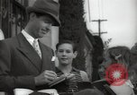Image of Hollywood Actor give autographs Los Angeles California USA, 1936, second 22 stock footage video 65675032817