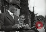 Image of Hollywood Actor give autographs Los Angeles California USA, 1936, second 23 stock footage video 65675032817