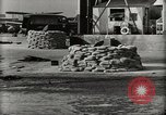 Image of Wrecked Planes Hangars and Ships Pearl Harbor Hawaii USA, 1942, second 10 stock footage video 65675033414