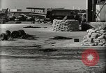Image of Wrecked Planes Hangars and Ships Pearl Harbor Hawaii USA, 1942, second 13 stock footage video 65675033414