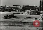 Image of Wrecked Planes Hangars and Ships Pearl Harbor Hawaii USA, 1942, second 14 stock footage video 65675033414