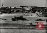 Image of Wrecked Planes Hangars and Ships Pearl Harbor Hawaii USA, 1942, second 15 stock footage video 65675033414