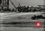 Image of Wrecked Planes Hangars and Ships Pearl Harbor Hawaii USA, 1942, second 16 stock footage video 65675033414