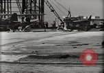 Image of Wrecked Planes Hangars and Ships Pearl Harbor Hawaii USA, 1942, second 17 stock footage video 65675033414