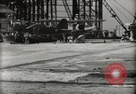 Image of Wrecked Planes Hangars and Ships Pearl Harbor Hawaii USA, 1942, second 18 stock footage video 65675033414