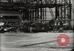 Image of Wrecked Planes Hangars and Ships Pearl Harbor Hawaii USA, 1942, second 20 stock footage video 65675033414