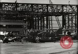 Image of Wrecked Planes Hangars and Ships Pearl Harbor Hawaii USA, 1942, second 21 stock footage video 65675033414