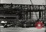 Image of Wrecked Planes Hangars and Ships Pearl Harbor Hawaii USA, 1942, second 22 stock footage video 65675033414