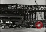 Image of Wrecked Planes Hangars and Ships Pearl Harbor Hawaii USA, 1942, second 24 stock footage video 65675033414