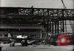 Image of Wrecked Planes Hangars and Ships Pearl Harbor Hawaii USA, 1942, second 26 stock footage video 65675033414