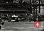 Image of Wrecked Planes Hangars and Ships Pearl Harbor Hawaii USA, 1942, second 27 stock footage video 65675033414