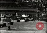 Image of Wrecked Planes Hangars and Ships Pearl Harbor Hawaii USA, 1942, second 28 stock footage video 65675033414