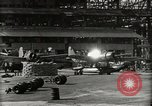 Image of Wrecked Planes Hangars and Ships Pearl Harbor Hawaii USA, 1942, second 30 stock footage video 65675033414
