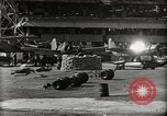Image of Wrecked Planes Hangars and Ships Pearl Harbor Hawaii USA, 1942, second 32 stock footage video 65675033414