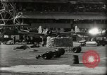 Image of Wrecked Planes Hangars and Ships Pearl Harbor Hawaii USA, 1942, second 33 stock footage video 65675033414