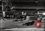 Image of Wrecked Planes Hangars and Ships Pearl Harbor Hawaii USA, 1942, second 34 stock footage video 65675033414