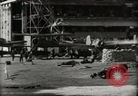 Image of Wrecked Planes Hangars and Ships Pearl Harbor Hawaii USA, 1942, second 35 stock footage video 65675033414