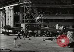 Image of Wrecked Planes Hangars and Ships Pearl Harbor Hawaii USA, 1942, second 37 stock footage video 65675033414
