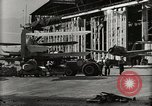 Image of Wrecked Planes Hangars and Ships Pearl Harbor Hawaii USA, 1942, second 49 stock footage video 65675033414
