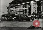 Image of Wrecked Planes Hangars and Ships Pearl Harbor Hawaii USA, 1942, second 50 stock footage video 65675033414
