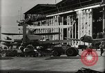 Image of Wrecked Planes Hangars and Ships Pearl Harbor Hawaii USA, 1942, second 51 stock footage video 65675033414