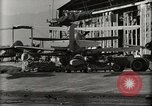 Image of Wrecked Planes Hangars and Ships Pearl Harbor Hawaii USA, 1942, second 54 stock footage video 65675033414
