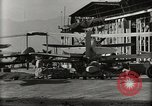 Image of Wrecked Planes Hangars and Ships Pearl Harbor Hawaii USA, 1942, second 55 stock footage video 65675033414
