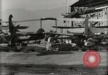 Image of Wrecked Planes Hangars and Ships Pearl Harbor Hawaii USA, 1942, second 56 stock footage video 65675033414