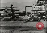 Image of Wrecked Planes Hangars and Ships Pearl Harbor Hawaii USA, 1942, second 57 stock footage video 65675033414