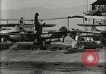 Image of Wrecked Planes Hangars and Ships Pearl Harbor Hawaii USA, 1942, second 58 stock footage video 65675033414