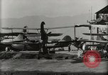 Image of Wrecked Planes Hangars and Ships Pearl Harbor Hawaii USA, 1942, second 59 stock footage video 65675033414