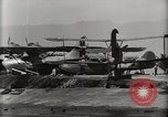 Image of Wrecked Planes Hangars and Ships Pearl Harbor Hawaii USA, 1942, second 60 stock footage video 65675033414