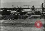 Image of Wrecked Planes Hangars and Ships Pearl Harbor Hawaii USA, 1942, second 61 stock footage video 65675033414