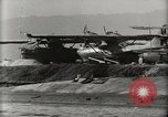Image of Wrecked Planes Hangars and Ships Pearl Harbor Hawaii USA, 1942, second 62 stock footage video 65675033414