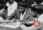Image of 1960s African American children Long Island New York USA, 1960, second 45 stock footage video 65675035581
