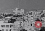 Image of White UN van displaying a white flag Tripoli Libya, 1962, second 14 stock footage video 65675039879