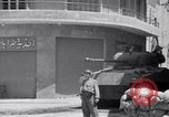 Image of White UN van displaying a white flag Tripoli Libya, 1962, second 32 stock footage video 65675039879